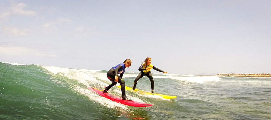 Learning to surf at our surfcamp at Fuerteventura on the 25.07.2014