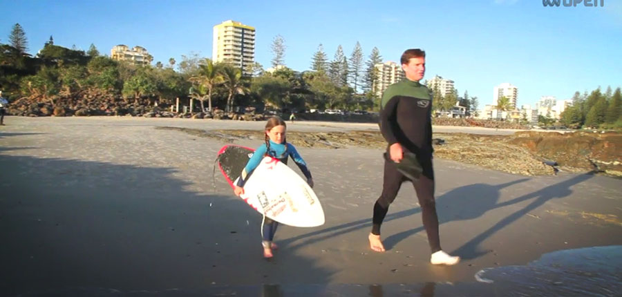 Surfing in the age of 6: Quincy is one of the biggest in the water