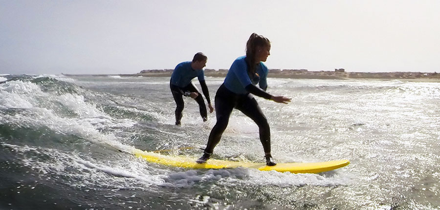 Learning to surf at Fuerteventura in our surf courses on the 07.08.2014