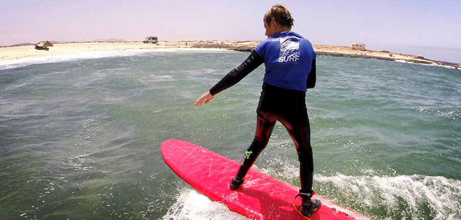 Learning to surf in our surf courses at Fuerteventura
