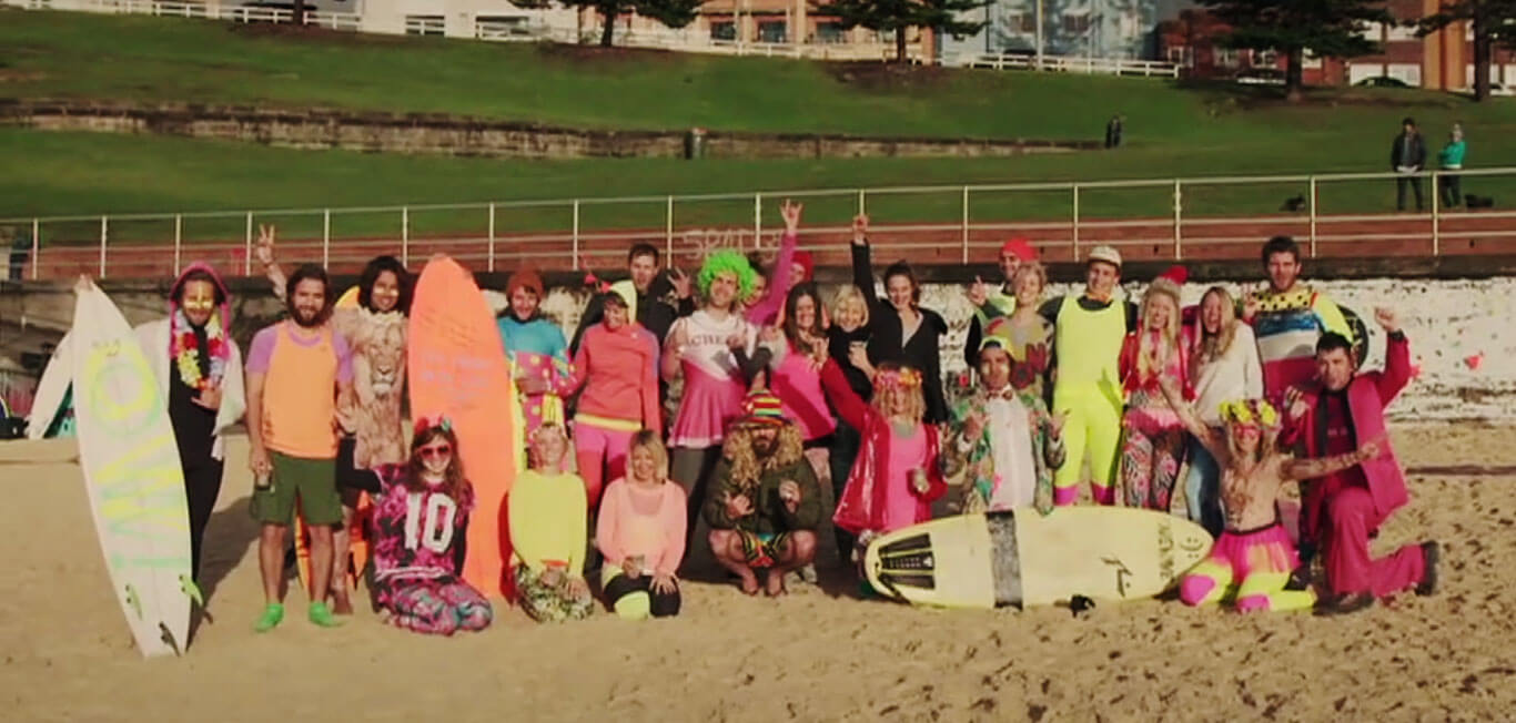 One wave is all it takes – raising awareness for mental health issues by surfing in bright colors on Fluro Friday